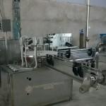 Máy chiết rót đóng nắp dầu gió